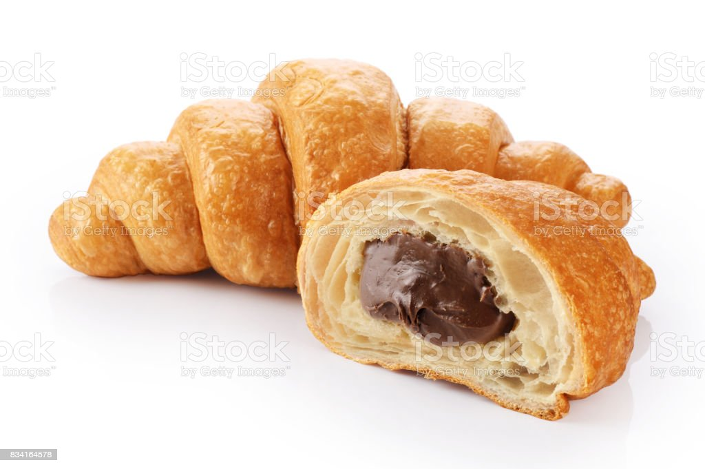 Sliced croissant with chocolate isolated on white background stock photo