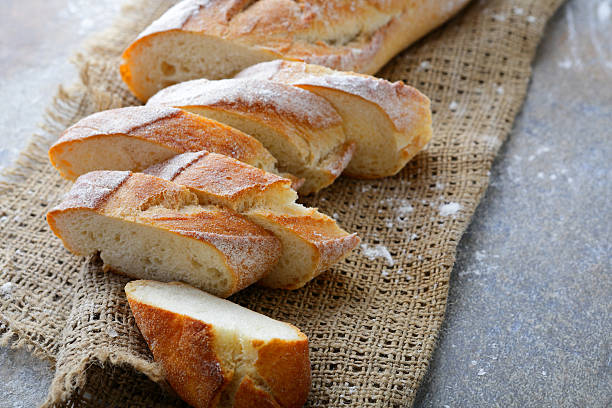 Sliced crunchy Baguette on the sackcloth stock photo