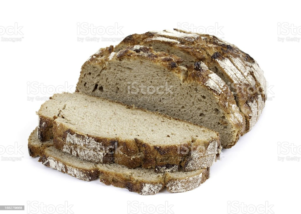 Sliced crusty whole grain bread isolated on white stock photo