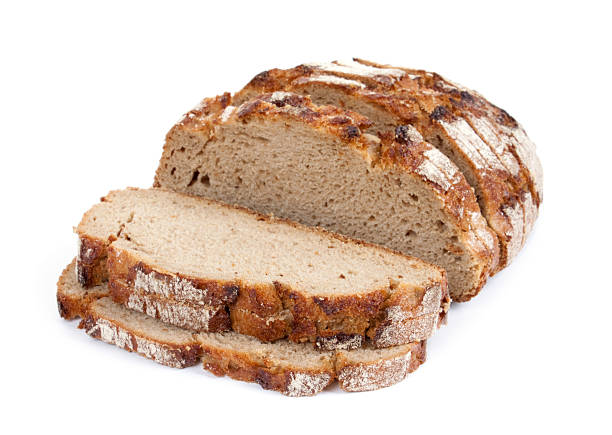 Sliced crusty whole grain bread isolated on white Sliced crusty whole wheat bread on white background round loaf stock pictures, royalty-free photos & images