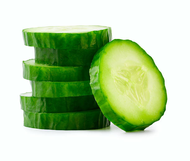 sliced cucumber in stack - cucumber stock photos and pictures