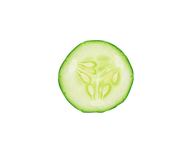 sliced cucumber isolated on white background stock photo