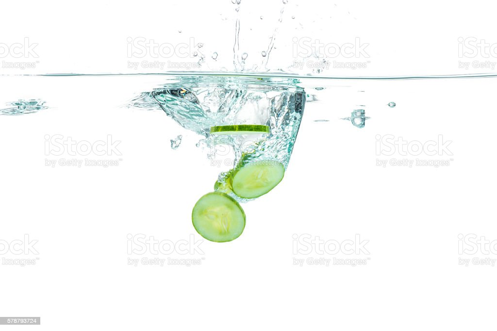 Sliced cucumber splashing water. Healthy and tasty food stock photo