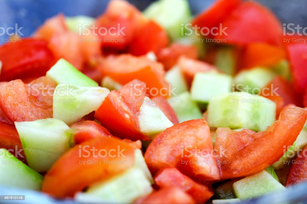 Sliced cucumbers and tomatoes close up. Sliced cucumbers and tomatoes close up. Horizontal view. Bright Stock Photo