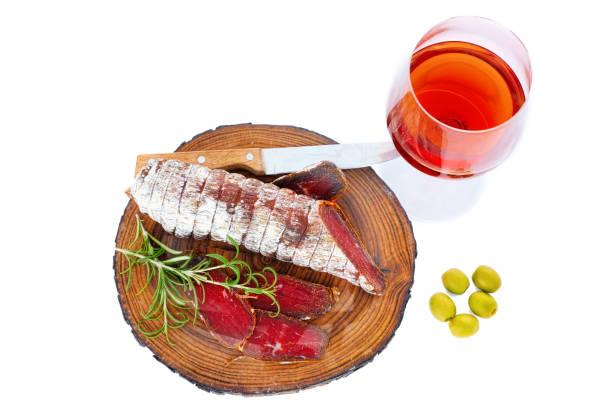 Sliced cured bresaola with a sprig of rosemary for a glass of wine picture id999093492?b=1&k=6&m=999093492&s=612x612&w=0&h=khkh xbtgg0 zvlw ebol8bt2mshgnlnwrwunyjzk6g=