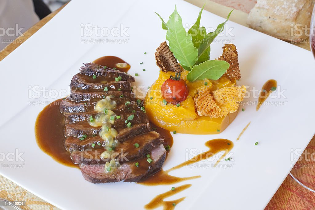 Sliced Duck Breast, Puree of Yam, Cherry Tomato. royalty-free stock photo