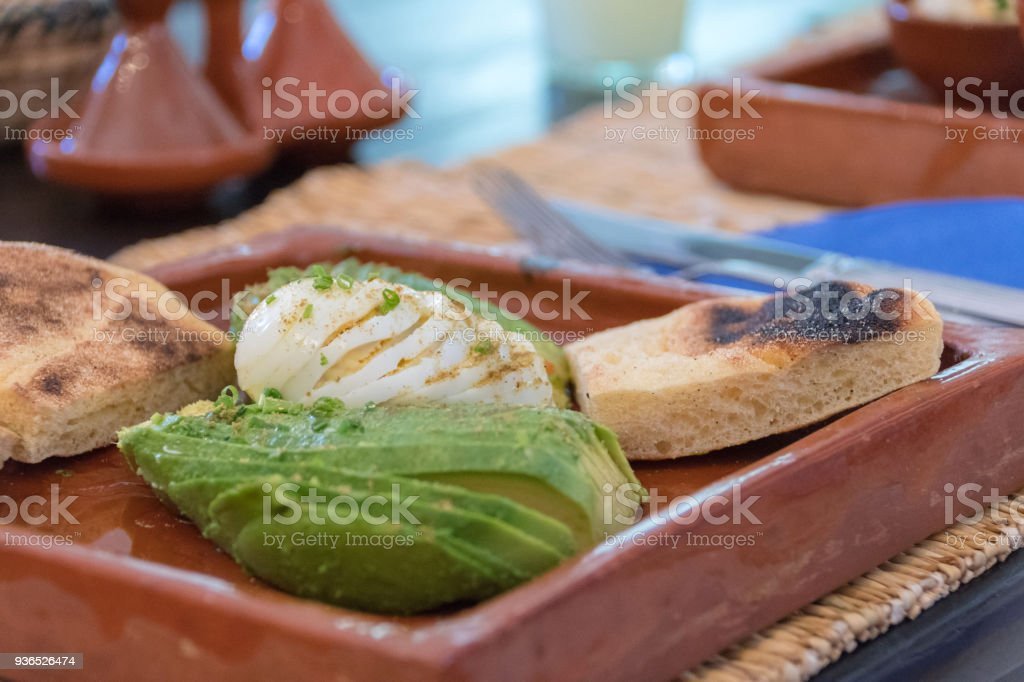 Sliced egg and avocado with sour dough toast stock photo