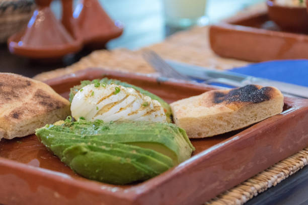 Sliced egg and avocado with sour dough toast stock photo