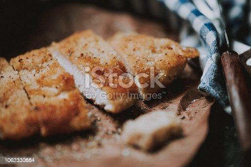 Sliced escalope on dark rustic background
