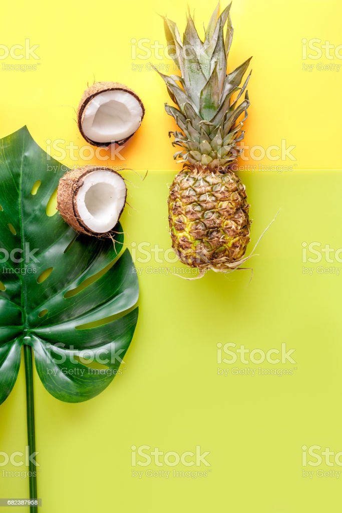 sliced exotic fruits on yellow background top view space for text royalty-free stock photo
