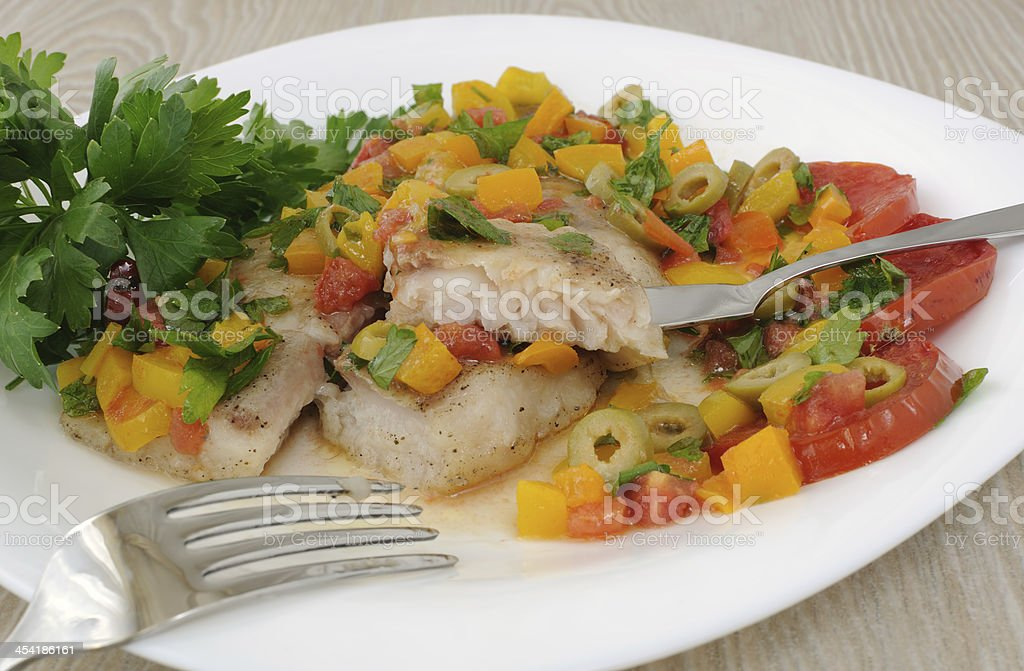 Sliced fish with vegetables royalty-free stock photo