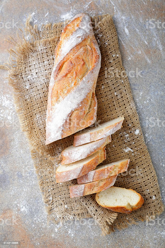 Sliced French Baguette on the sackcloth stock photo