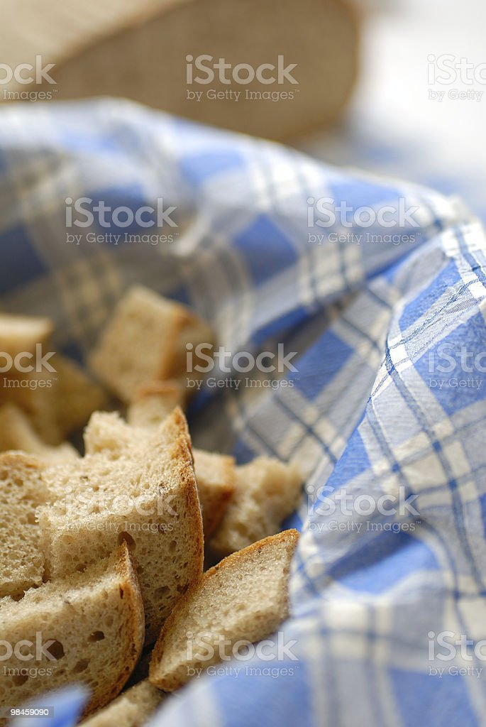 sliced fresh bread on the table, detail royalty-free stock photo
