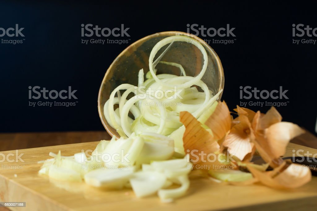 Sliced Fresh onion and Ripe onion on wooden background. Selective focus foto de stock royalty-free