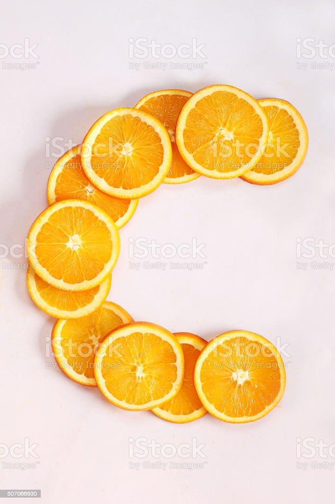 sliced fresh oranges arranged in c shape stock photo