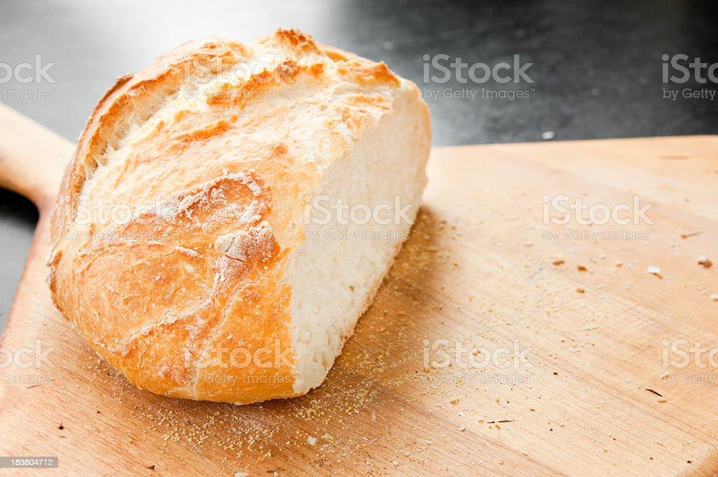 Sliced Freshly Baked Boule on Paddle royalty-free stock photo