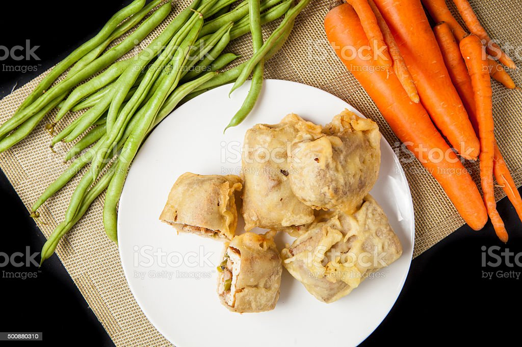 Sliced Fried Tofu with vegetables, traditional indonesian food stock photo