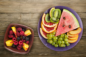 sliced fruit on a wooden background. sliced fruit on a plate
