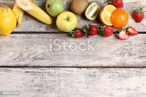 istock Sliced fruits isolated on wooden textured laminate 626515206