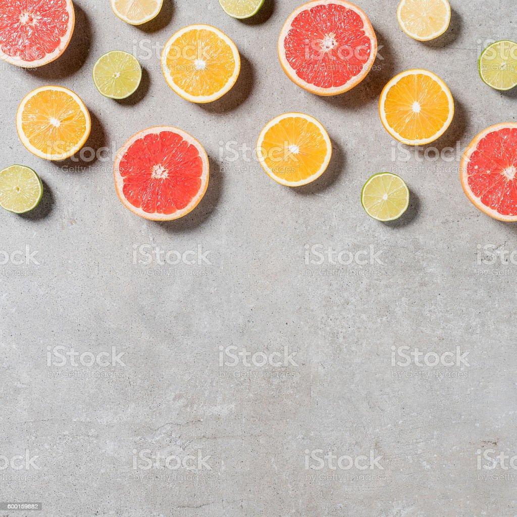 Sliced fruits on gray stone table stock photo
