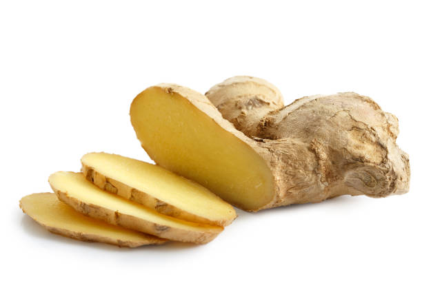 sliced ginger root isolated on white. - ginger stock photos and pictures