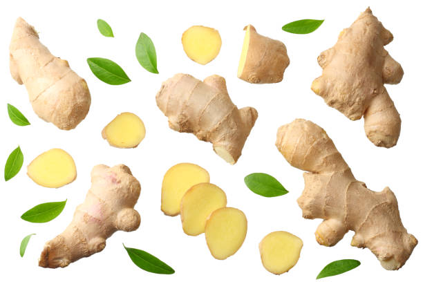 sliced ginger with leaves isolated on white background top view sliced ginger with leaves isolated on white background top view ginger spice stock pictures, royalty-free photos & images