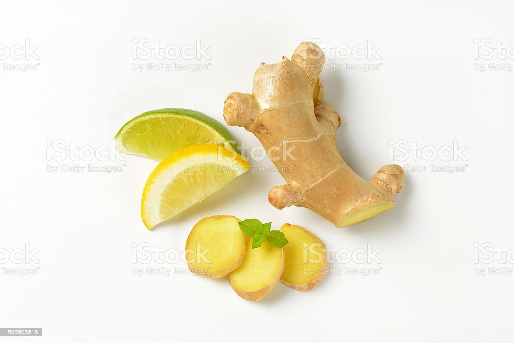 sliced ginger with lemon and lime stock photo