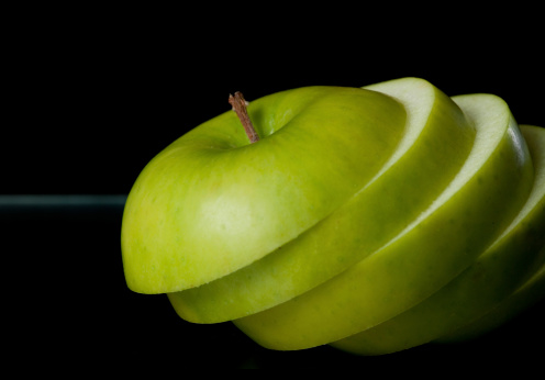 Sliced Green Apple Closeup Stock Photo - Download Image Now