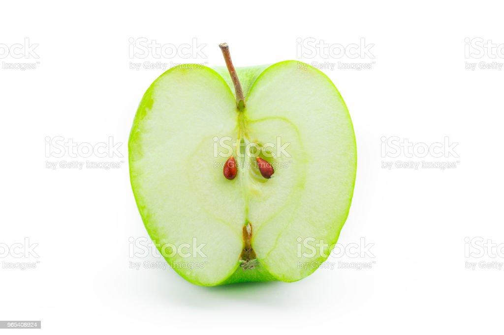 Tranches de pomme verte, isolé sur le fond blanc - Photo de Aliment libre de droits