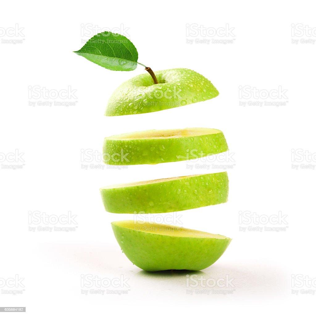 sliced green apple levitating on white background ストックフォト