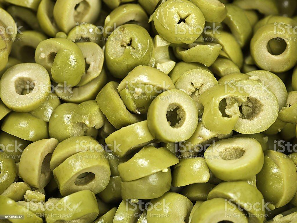 Sliced green olives background stock photo
