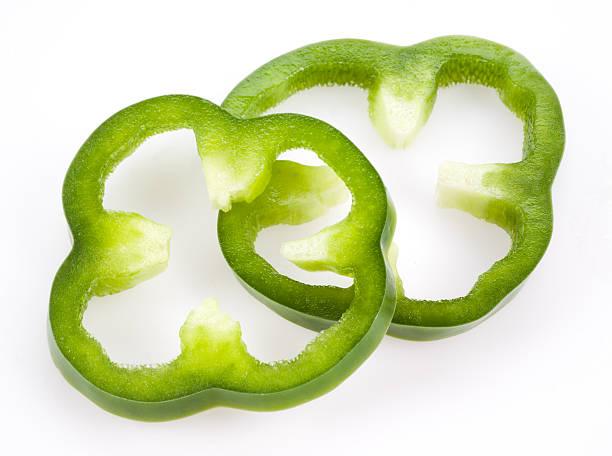 Sliced green pepper isolated on white stock photo