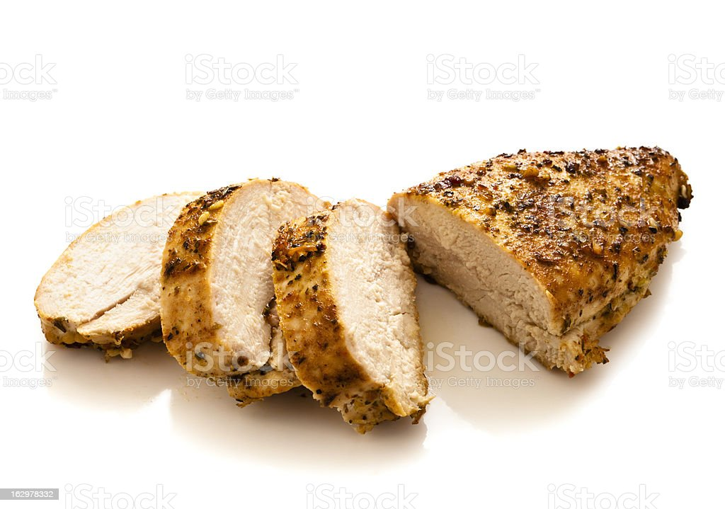 Sliced grilled and seasoned chicken breast stock photo