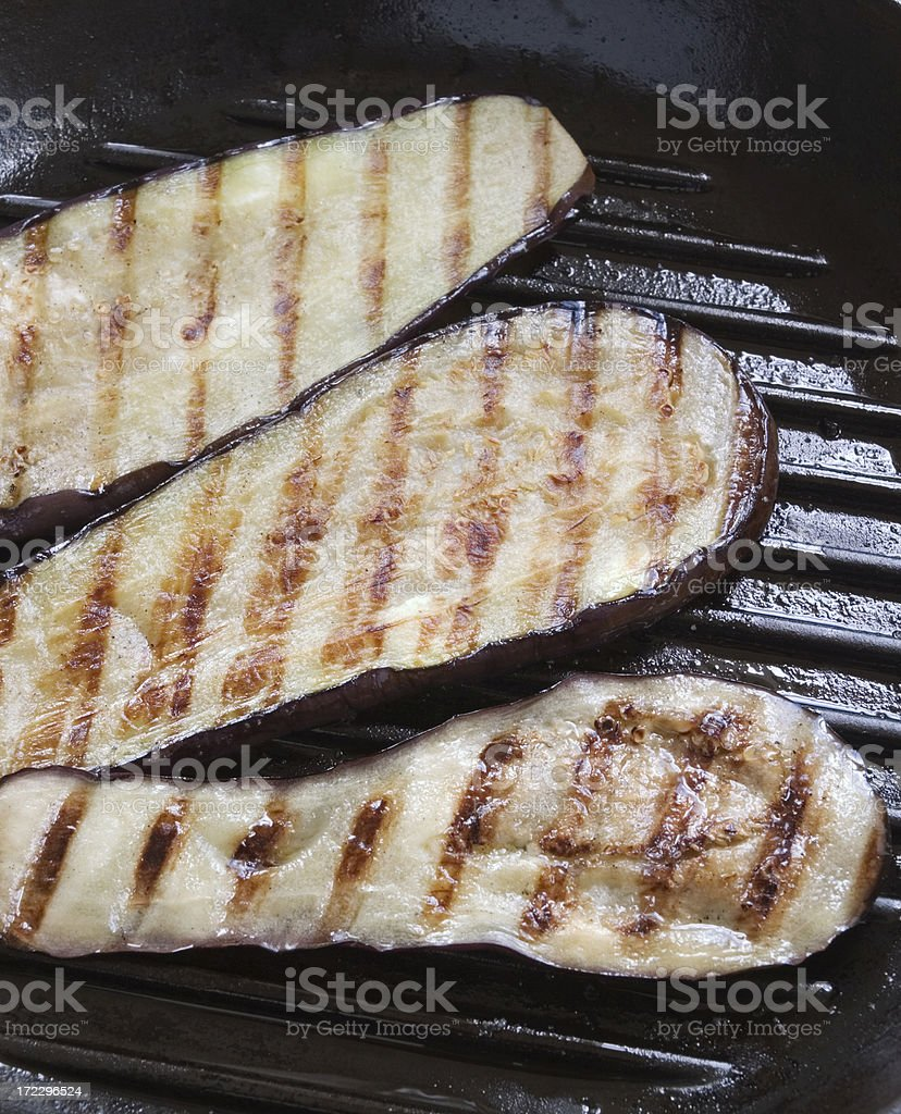 Sliced grilled aubergines close-up royalty-free stock photo