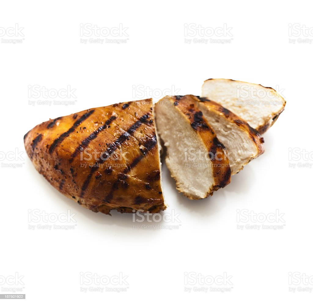 A sliced grilled chicken breast on a white background stock photo