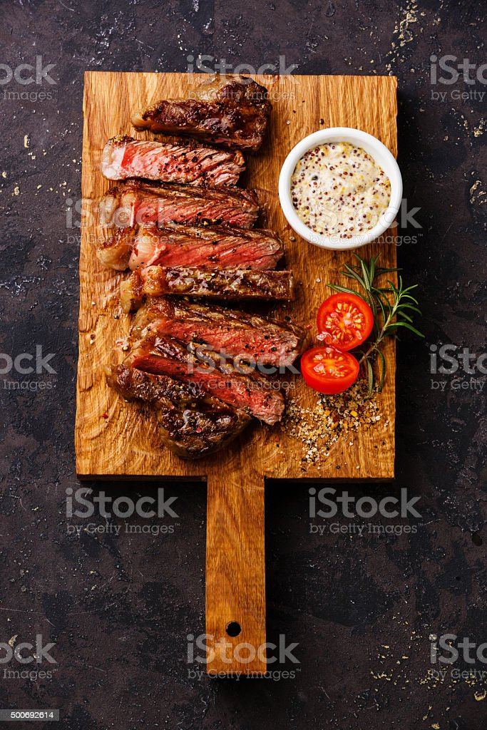 Sliced grilled steak and Pepper sauce stock photo