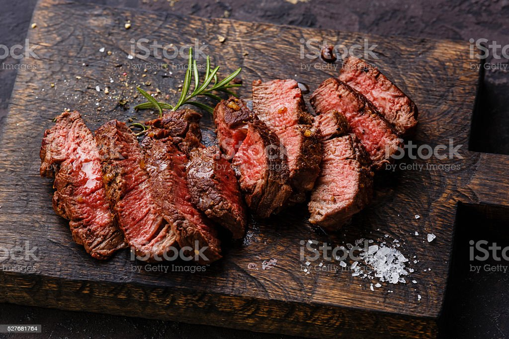 Sliced grilled steak roastbeef and rosemary stock photo