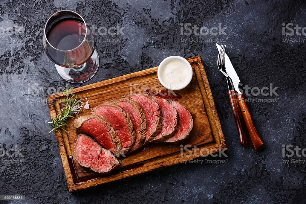 Sliced grilled tenderloin Steak roastbeef and Red wine stock photo