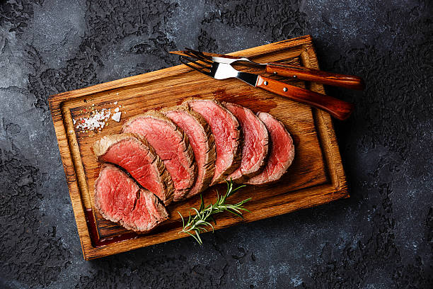 sliced grilled tenderloin steak roastbeef - beef stock pictures, royalty-free photos & images