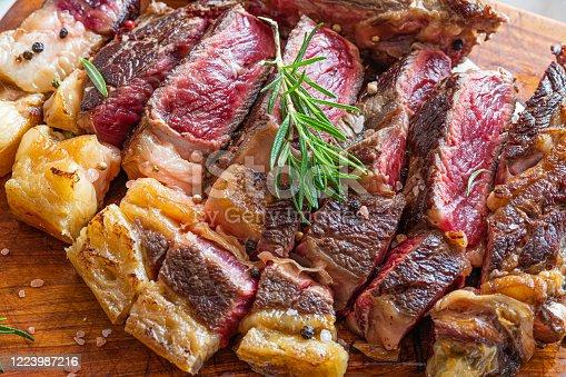 istock Sliced grilled vaca rubia gallega steak on wooden board with seasonings 1223987216