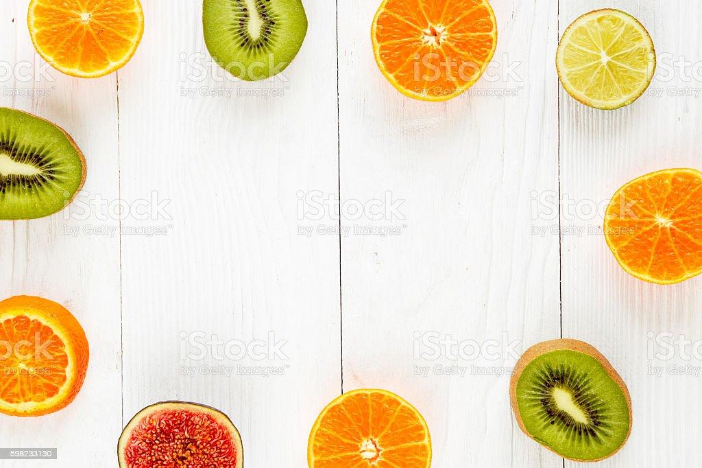 sliced halves of citrus and kiwi on white background foto royalty-free