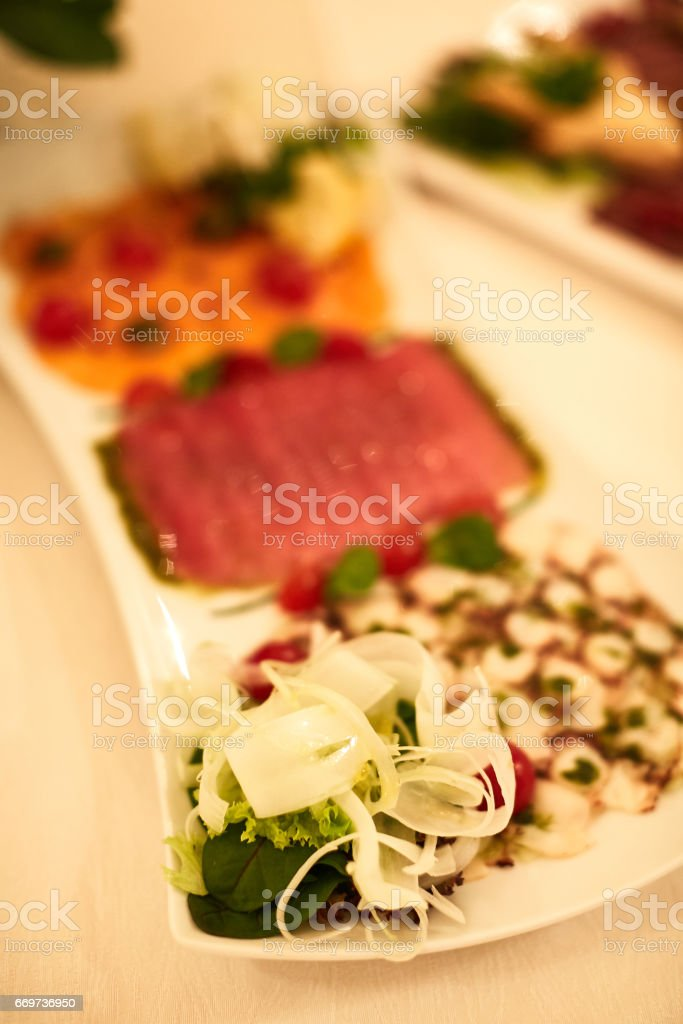 Sliced ham with lettuce, shallow depth, selective focus stock photo
