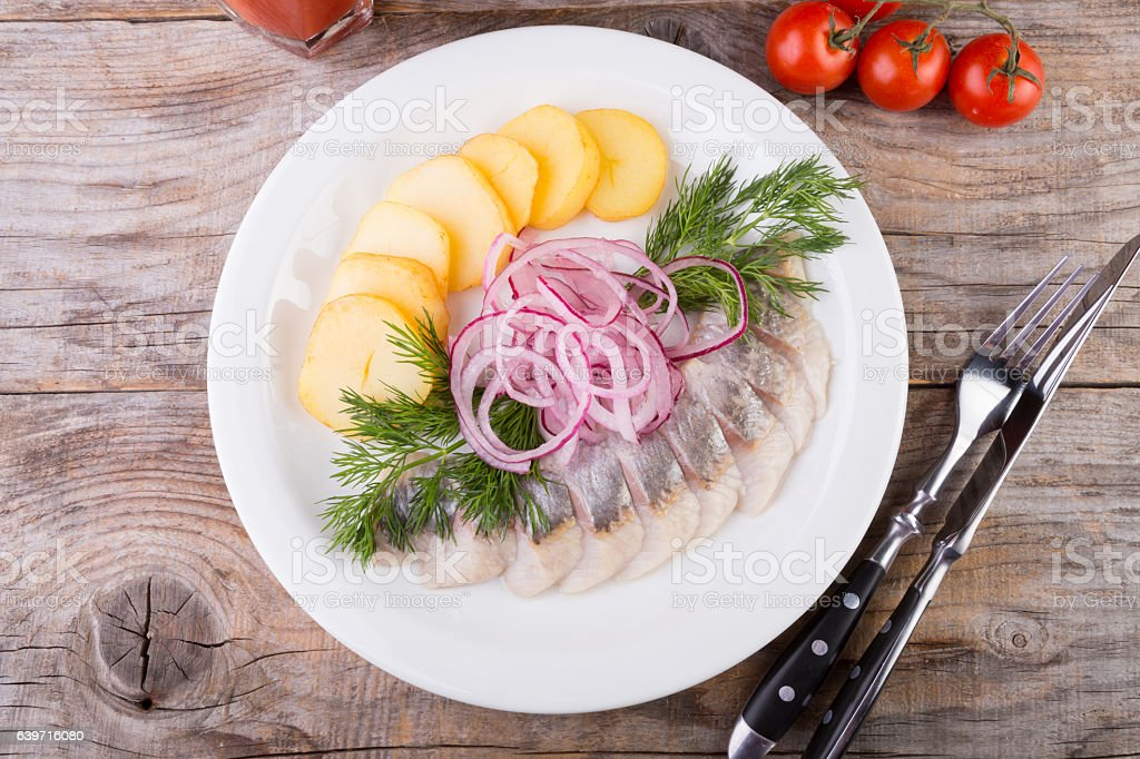 Sliced herring with potatoes stock photo