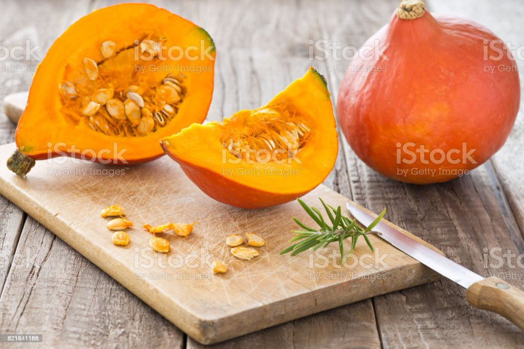 Sliced hokkaido pumpkin on a wooden board stock photo
