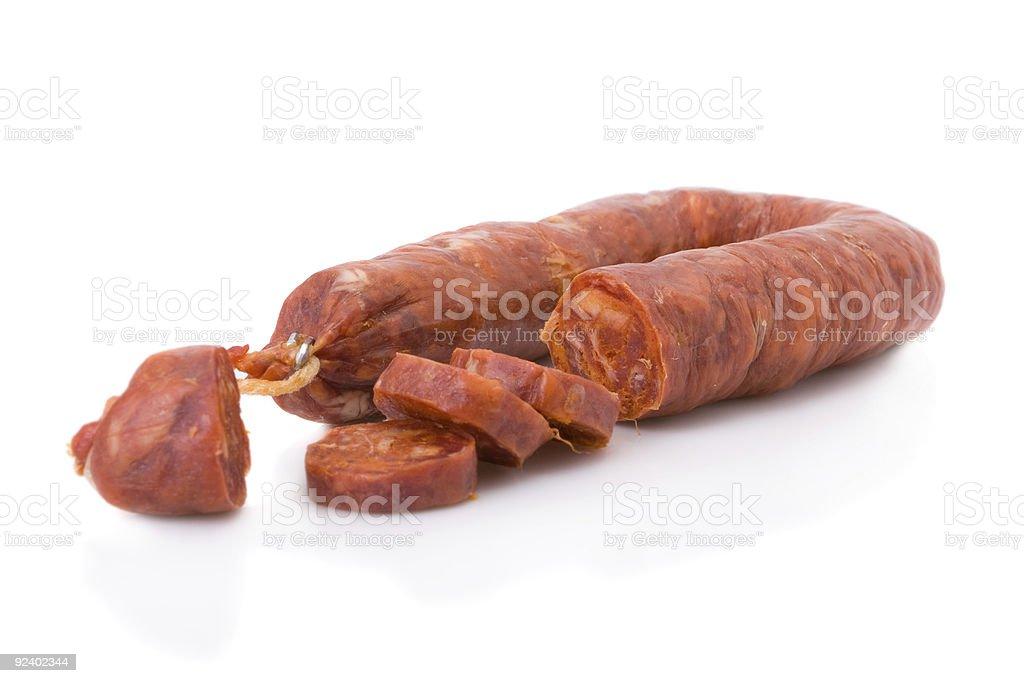 Sliced Iberian chorizo from Portugal isolated on white stock photo
