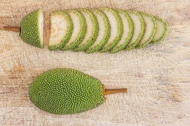 sliced immature jackfruit - jackfrucht stock-fotos und bilder