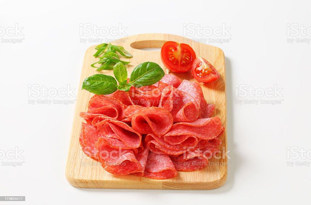 Sliced Italian salami on a cutting board royalty-free stock photo