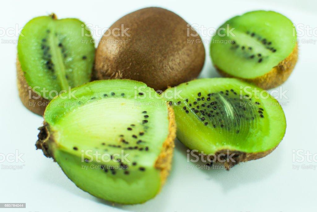 Sliced juicy green kiwi on white background royalty-free stock photo