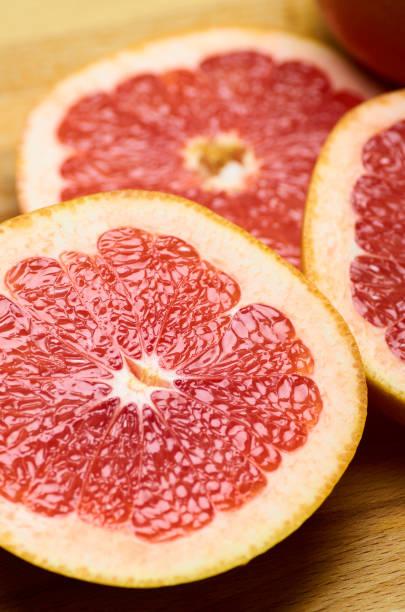 sliced juicy red grapefruit close up