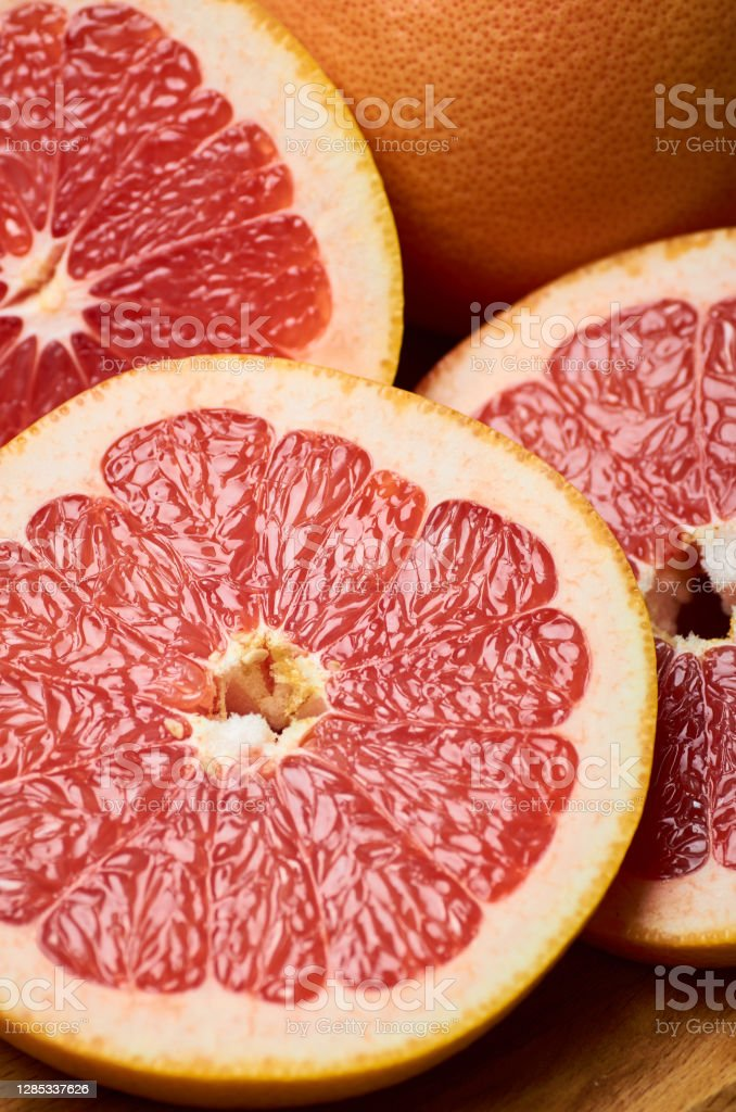 sliced juicy red grapefruit close up sliced juicy red grapefruit close up, vertically Bright Stock Photo